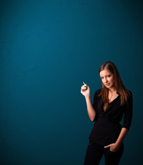Beautiful woman smoking cigarette vith copy space