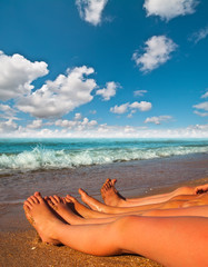 bare feet of children on the beach