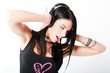 Sensual brunette girl listening to music