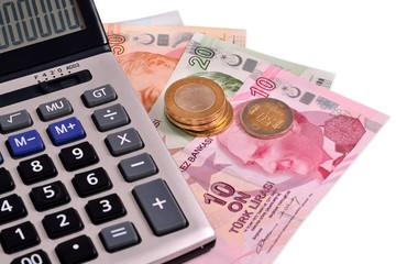Turkish money and calculating machine on white background