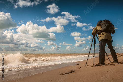 Landscape photographer work on sea coast