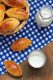 Fresh baked pasties with milk