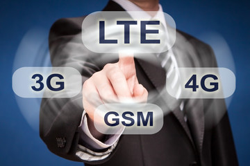 businessman pushing finger on lte button