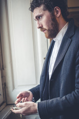 handsome hipster elegant man with pocket watch