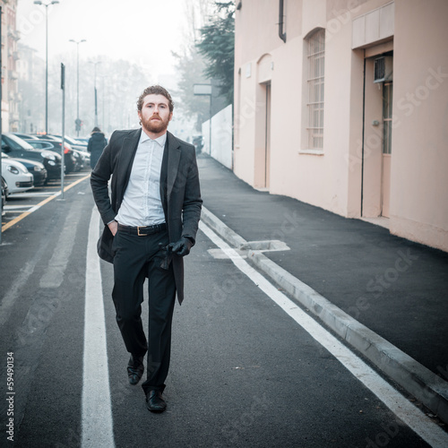 handsome hipster elegant man in the city