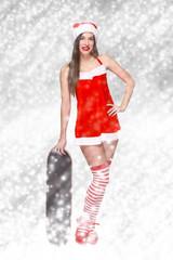 Sexy santa woman with snowboard