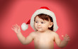 Adorable baby girl with Christmas hat