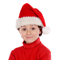 Funny child with Christmas hat in red