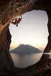 Female rock climber at sunset, Kalymnos Island, Greece