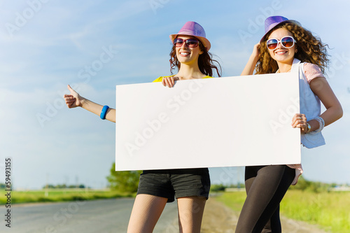 Two girls with banner