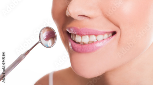 Smiling mouth of a woman showing her healthy teeth