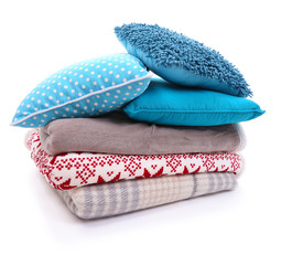 Colorful pillows and plaids isolated on white
