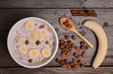 bowl of muesli and millk with fresh banana
