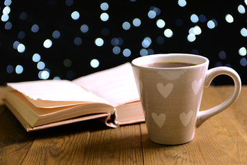 Composition of book with cup of coffee