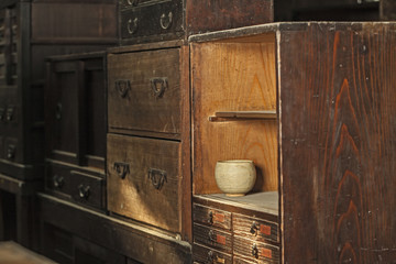 Ceramic bowl in wooden cabinet (Still life)