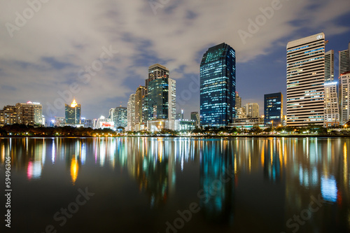 Skyline cityscape at twilight reflect on water
