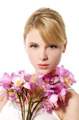 beautiful healthy blond girl with branch pink flower