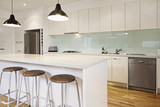 White contemporary kitchen with island