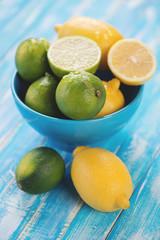 Still life of lemons and limes, vertical shot