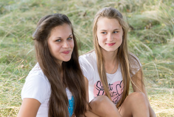 Two girls of 14 years on the nature