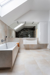 Bright bathroom with huge bath