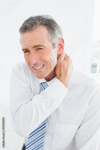 Mature man suffering from neck pain