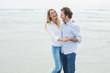 Cheerful couple dancing at beach