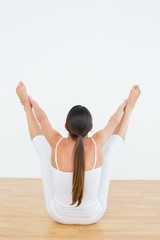 Toned woman doing the balancing bear posture