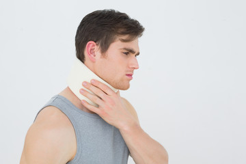 Side view of a young man wearing cervical collar