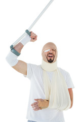 Cheerful man with broken hand and crutch cheering