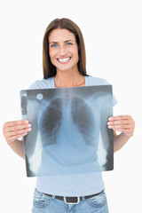 Portrait of a smiling young woman holding lung x-ray