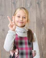Smiling girl showing thumbs up