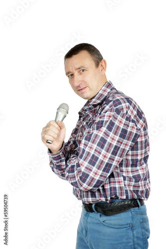 Man speaks to microphone