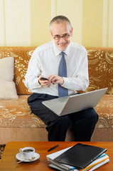 Senior Businessman Typing an Sms