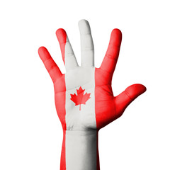 Open hand raised, Canada flag painted