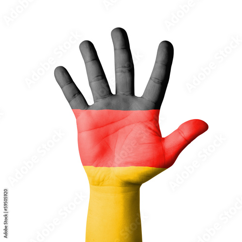 Open hand raised, Germany flag painted