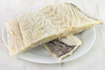 salted fish on white plate