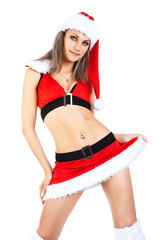 Studio portrait of a sexy young woman dressed as Santa.