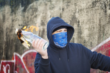 Man with a burning Molotov cocktail at the hands of