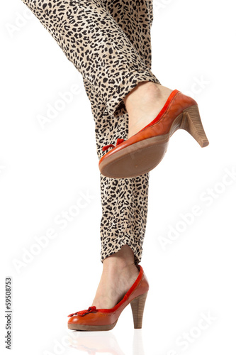 Woman legs and red high heels