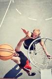 Fototapeta Two basketball players on the court