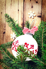 Christmas background with  fir branches and festive ornaments ov