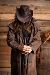 cowboy duster long hair rifle look down wall
