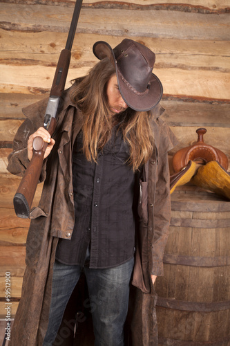 cowboy duster long hair rifle over shoulder by wall