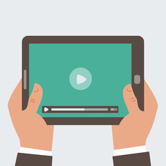 Businessman holding tablet computer  with video player
