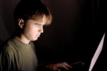 Man at the computer at night