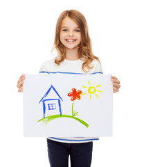 smiling little child holding picture of house