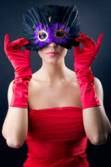 Woman with red dress and carnival mask