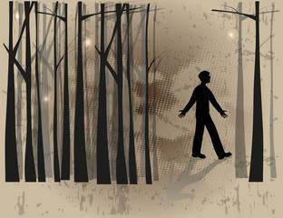 silhouette di uomo che si è perso nel bosco