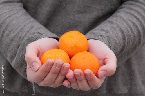 Hands holding fresh fruit